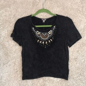 Distressed t shirt with neckline decoration